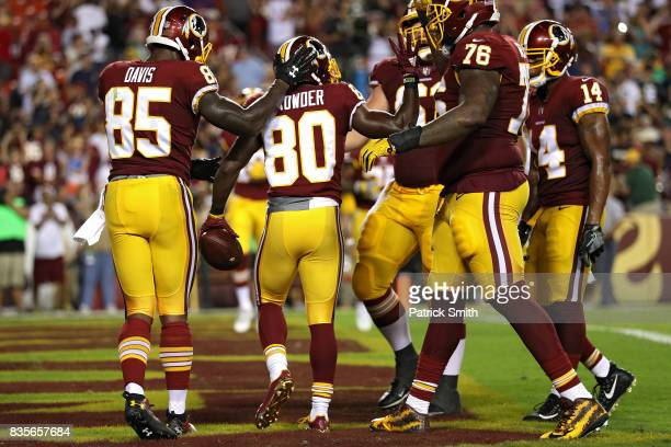 Wide receiver Jamison Crowder of the Washington Redskins celebrates a touchdown with teammates against the Green Bay Packers in the first half during...