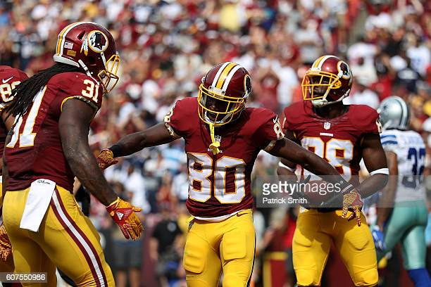 Wide receiver Jamison Crowder of the Washington Redskins celebrates with teammate running back Matt Jones after scoring a third quarter touchdown...