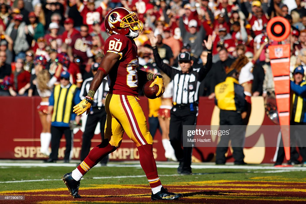 Wide receiver <a gi-track='captionPersonalityLinkClicked' href=/galleries/search?phrase=Jamison+Crowder&family=editorial&specificpeople=8230117 ng-click='$event.stopPropagation()'>Jamison Crowder</a> #80 of the Washington Redskins scores a first quarter touchdown during a game against the New Orleans Saints at FedExField on November 15, 2015 in Landover, Maryland.