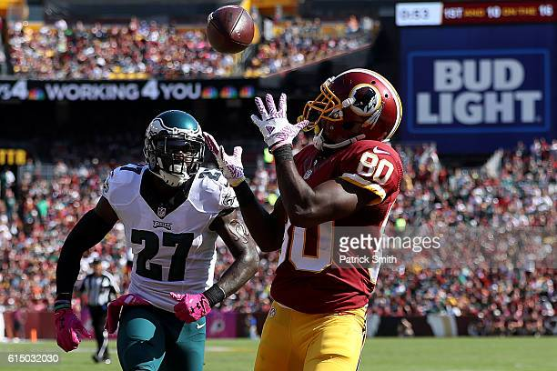 Wide receiver Jamison Crowder of the Washington Redskins scores a first quarter touchdown past strong safety Malcolm Jenkins of the Philadelphia...