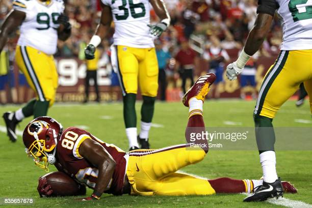 Wide receiver Jamison Crowder of the Washington Redskins scores a touchdown against the Green Bay Packers in the first half during a preseason game...