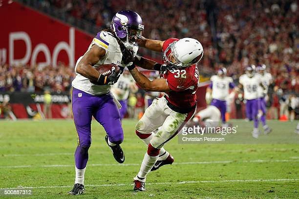 Wide receiver Jarius Wright of the Minnesota Vikings is tackled by free safety Tyrann Mathieu of the Arizona Cardinals after a reception during the...