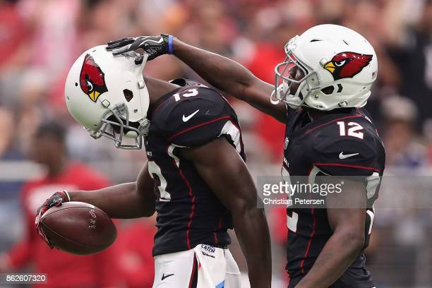 Wide receiver Jaron Brown of the Arizona Cardinals is congratulated byJohn Brown during the first half of the NFL game against the Tampa Bay...