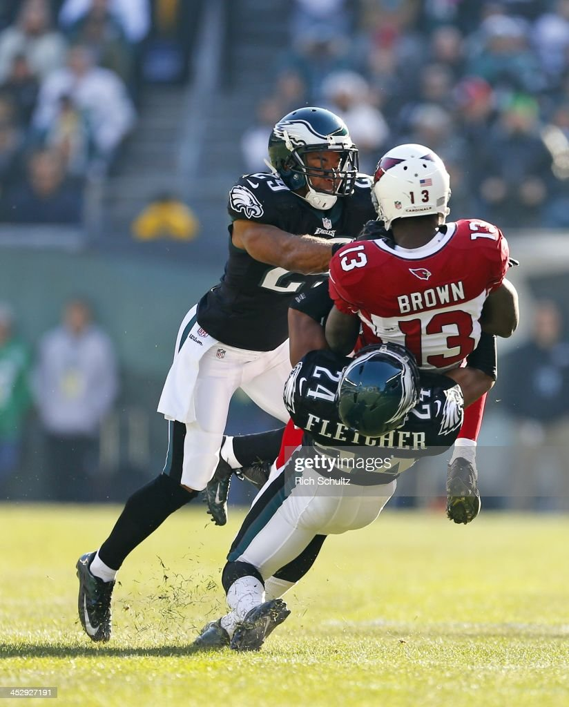 Wide receiver <a gi-track='captionPersonalityLinkClicked' href=/galleries/search?phrase=Jaron+Brown&family=editorial&specificpeople=234953 ng-click='$event.stopPropagation()'>Jaron Brown</a> #13 of the Arizona Cardinals is tackled by safety Nate Allen #29 and cornerback <a gi-track='captionPersonalityLinkClicked' href=/galleries/search?phrase=Bradley+Fletcher&family=editorial&specificpeople=4620736 ng-click='$event.stopPropagation()'>Bradley Fletcher</a> #24 of the Philadelphia Eagles in the first quarter during a game at Lincoln Financial Field on December 1, 2013 in Philadelphia, Pennsylvania. The Eagles defeated the Cardinals 24-21.