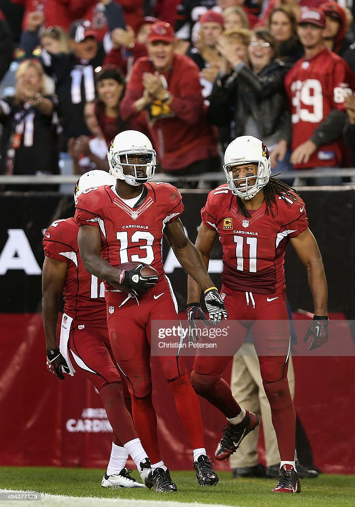 Wide receiver <a gi-track='captionPersonalityLinkClicked' href=/galleries/search?phrase=Jaron+Brown&family=editorial&specificpeople=234953 ng-click='$event.stopPropagation()'>Jaron Brown</a> #13 of the Arizona Cardinals reacts alongside wide receiver <a gi-track='captionPersonalityLinkClicked' href=/galleries/search?phrase=Larry+Fitzgerald&family=editorial&specificpeople=183380 ng-click='$event.stopPropagation()'>Larry Fitzgerald</a> #11 after Brown had a 32 yard reception against the St. Louis Rams during the fourth quarter of the NFL game at the University of Phoenix Stadium on December 8, 2013 in Glendale, Arizona. The Cardinals defeated the Rams 30-10.