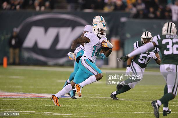 Wide Receiver Jarvis Landry of the Miami Dolphins has a long gain against the New York Jets at MetLife Stadium on December 17 2016 in East Rutherford...