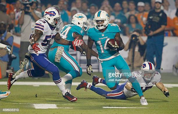 Wide receiver Jarvis Landry of the Miami Dolphins is pursued by outside linebacker Nigel Bradham of the Buffalo Bills in the first quarter of a game...