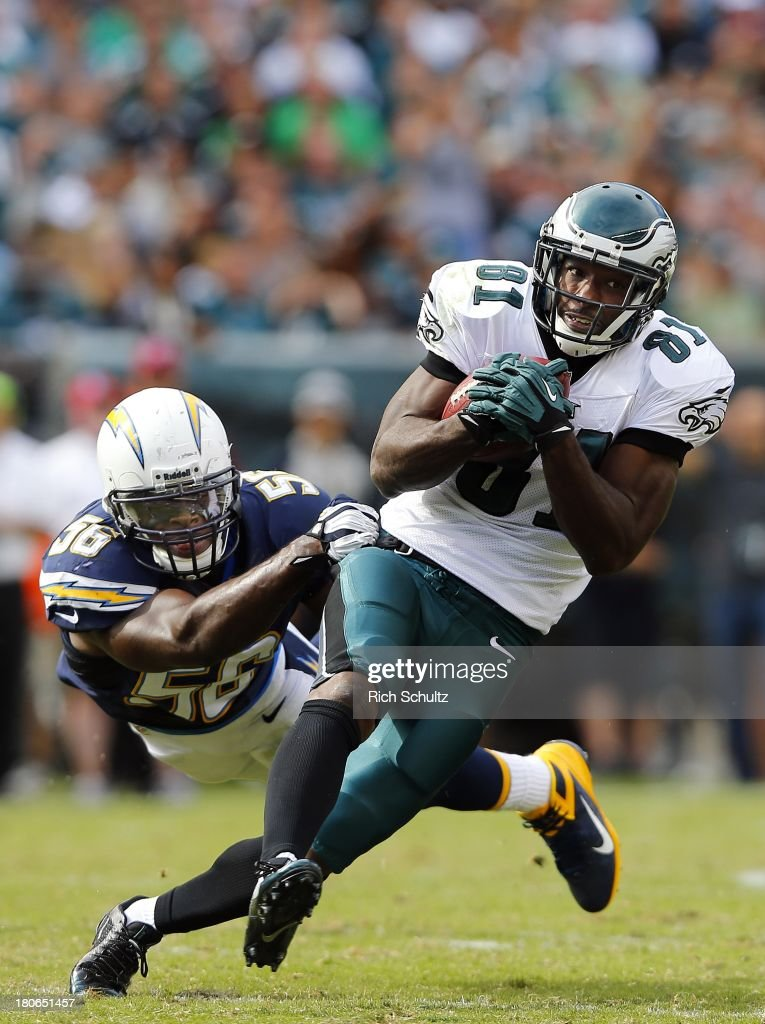 Wide receiver <a gi-track='captionPersonalityLinkClicked' href=/galleries/search?phrase=Jason+Avant&family=editorial&specificpeople=616486 ng-click='$event.stopPropagation()'>Jason Avant</a> #81 of the Philadelphia Eagles makes a 15 yard catch for a first down as linebacker <a gi-track='captionPersonalityLinkClicked' href=/galleries/search?phrase=Donald+Butler&family=editorial&specificpeople=4489433 ng-click='$event.stopPropagation()'>Donald Butler</a> #56 of the San Diego Chargers attempts a tackle during the fourth quarter in a game at Lincoln Financial Field on September 15, 2013 in Philadelphia, Pennsylvania. The Chargers defeated the Eagles 33-3.