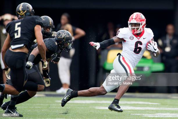 Wide receiver Javon Wims of the Georgia Bulldogs carries the ball during a game against the Vanderbilt Commodores at Vanderbilt Stadium on October 7...