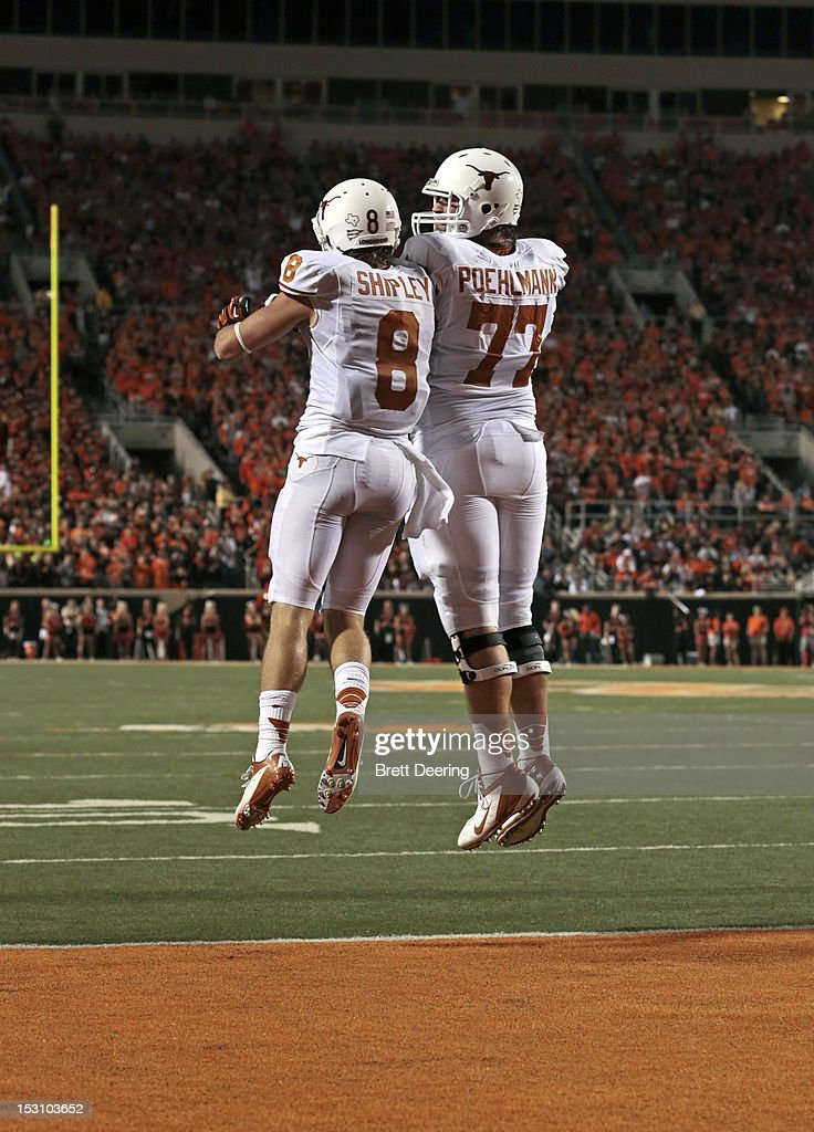 Wide receiver Jaxon Shipley #8 and offensive tackle Luke Poehlmann #77 of the Texas Longhorns celebrate a touchdown against the Oklahoma State Cowboys on September 29, 2012 at Boone Pickens Stadium in Stillwater, Oklahoma. Texas defeated Oklahoma State 41-36.