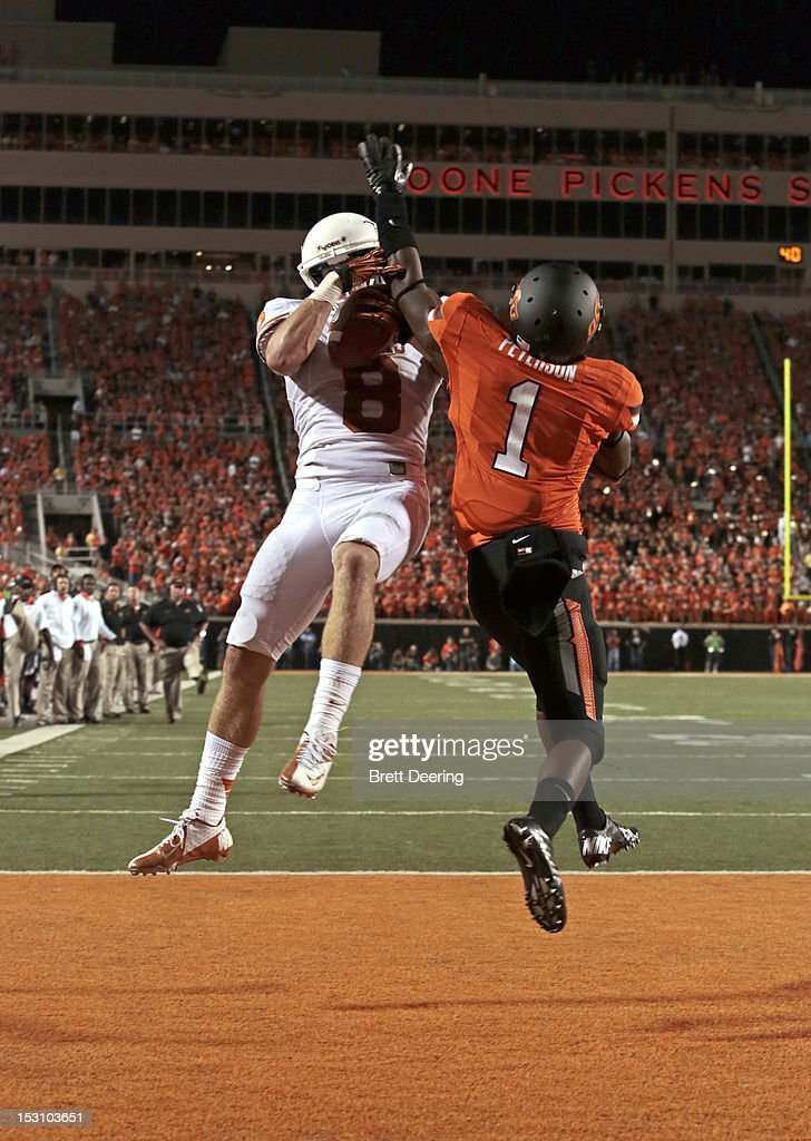 Wide receiver Jaxon Shipley #8 of the Texas Longhorns catches a ball in the end zone over cornerback Kevin Peterson #1 of the Oklahoma State Cowboys on September 29, 2012 at Boone Pickens Stadium in Stillwater, Oklahoma. Texas defeated Oklahoma State 41-36.