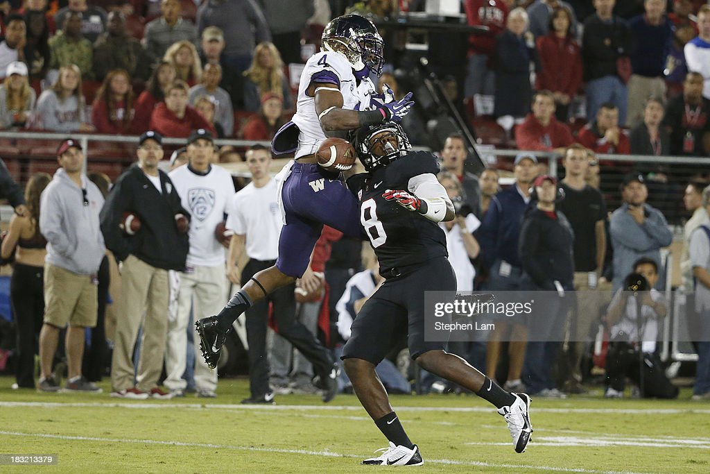 Wide receiver Jaydon Mickens #4 of the Washington Huskies couldn't complete a pass as safety Jordan Richards #8 of the Stanford Cardinal defends during the fourth quarter of their game on October 5, 2013 at Stanford Stadium in Stanford, California. The Cardinal defeated the Huskies 31-28.