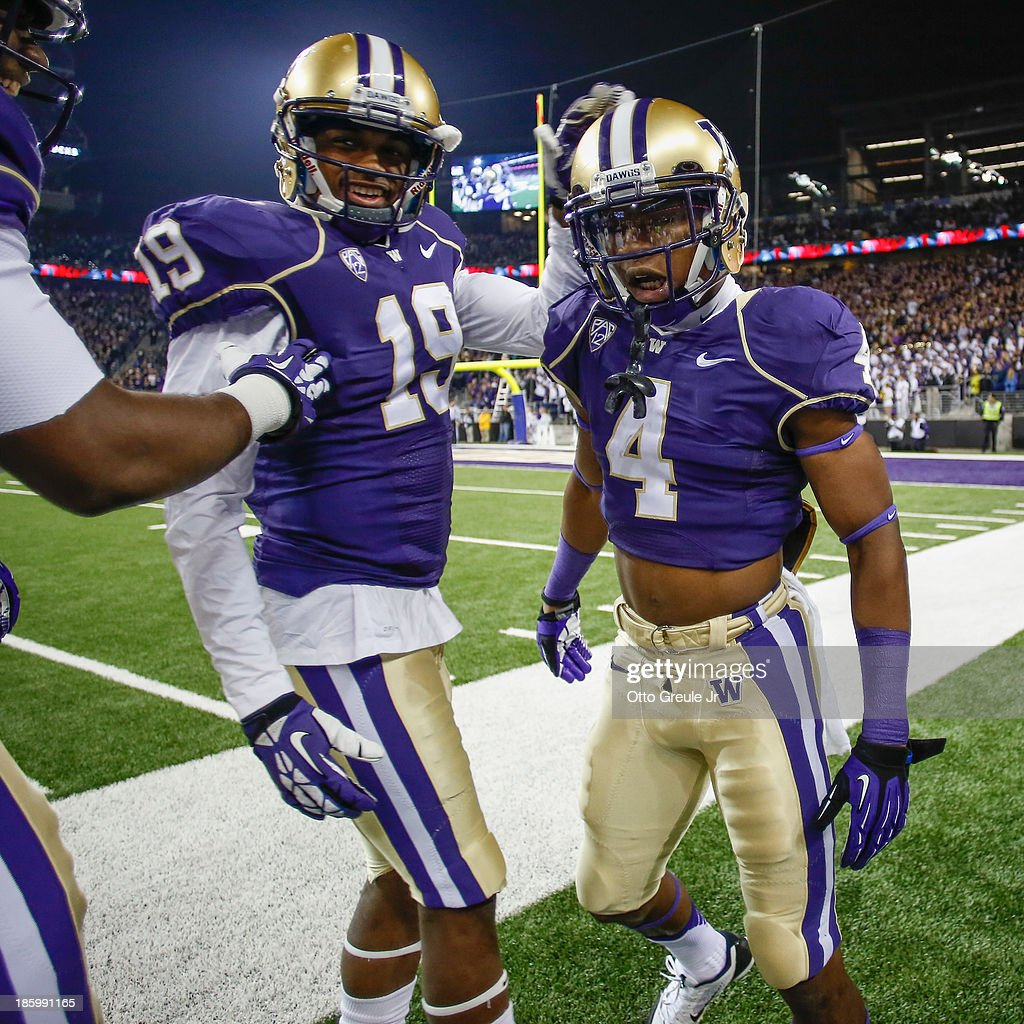 Wide receiver Jaydon Mickens #4 of the Washington Huskies is congratulated by DiAndre Campbell #19 after scoring a touchdown against the California Golden Bears in the first half on October 26, 2013 at Husky Stadium in Seattle, Washington. The Huskies defeated the Bears 41-17.