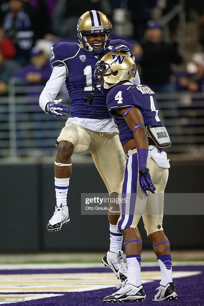 Wide receiver Jaydon Mickens #4 of the Washington Huskies is congratulated by DiAndre Campbell #19 after scoring a touchdown against the California Golden Bears in the third quarter on October 26, 2013 at Husky Stadium in Seattle, Washington.