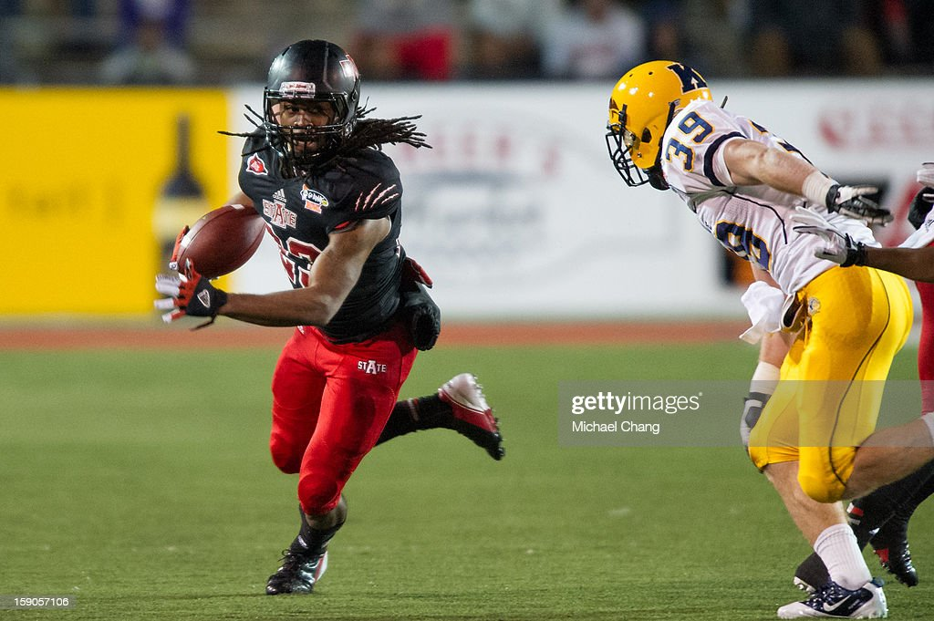 Wide receiver J.D. McKissic #23 of the Arkansas State Red Wolves looks to run past safety Luke Wollet #39 of the Kent State Golden Flashes on January 6, 2013 at Ladd-Peebles Stadium in Mobile, Alabama. Arkansas State defeated Kent State 17-13.
