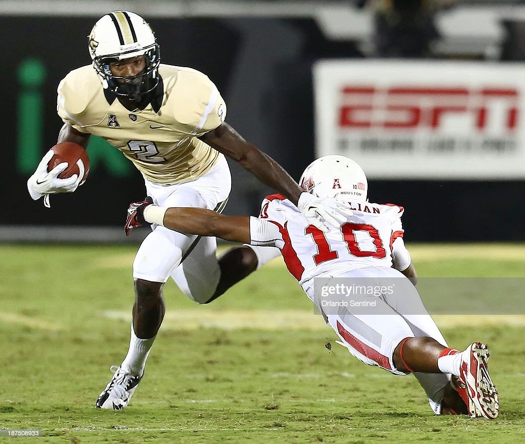 Wide receiver Jeff Godfrey (2) of Central Florida pulls away from defensive back Zach McMillian (10) of Houston at Bright House Networks Stadium in Orlando, Fla., on Saturday, Nov. 9, 2013.