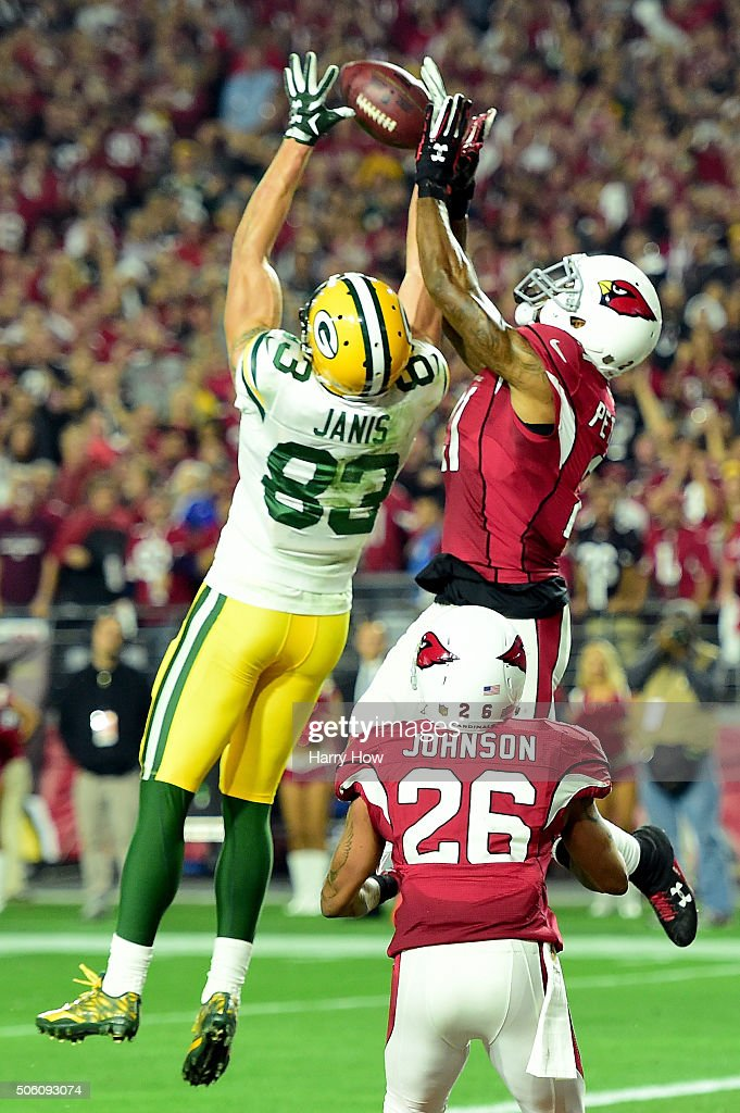 Wide receiver Jeff Janis #83 of the Green Bay Packers catches a 41-yard touchdown on the final play of regulation against cornerback Patrick Peterson #21 of the Arizona Cardinals in the NFC Divisional Playoff Game at University of Phoenix Stadium on January 16, 2016 in Glendale, Arizona.