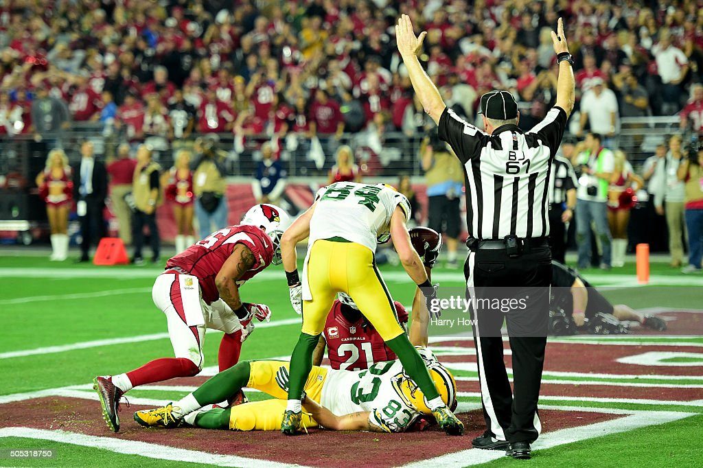 Wide receiver Jeff Janis of the Green Bay Packers celebrates after he catches a 41yard touchdown on the final play of regulation against cornerback...