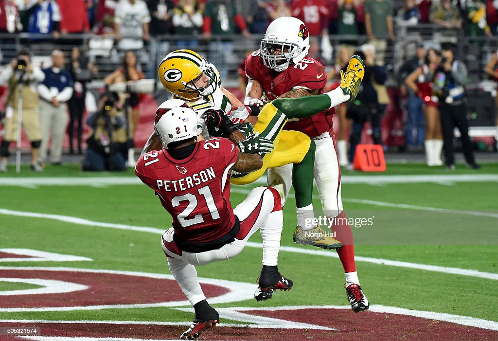 Wide receiver Jeff Janis #83 of the Green Bay Packers hauls in the game-tying pass at the end of regulation while being hit by cornerback Patrick Peterson #21 of the Arizona Cardinals (back) and free safety Rashad Johnson #26 during the fourth quarter of the NFC Divisional Playoff Game at University of Phoenix Stadium on January 16, 2016 in Glendale, Arizona. The Arizona Cardinals beat the Green Bay Packers 26-20 in overtime.