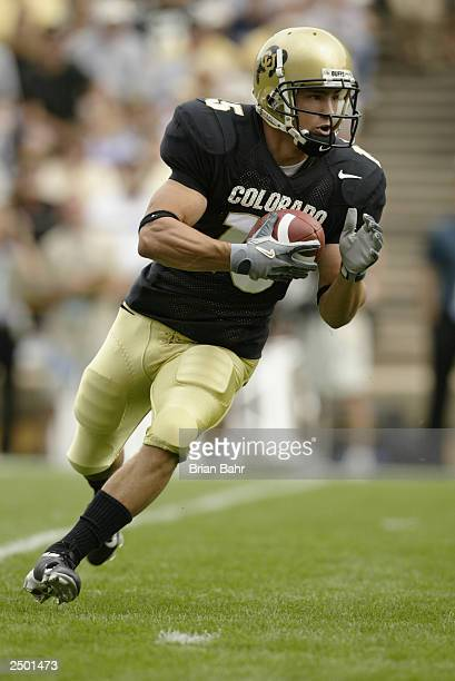 Wide receiver Jeremy Bloom of the Colorado Buffaloes runs a reverse against the UCLA Bruins on September 6 2003 at Folsom Field in Boulder Colorado...