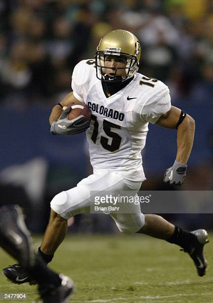 Wide receiver Jeremy Bloom of the University of Colorado Buffaloes carries the ball against the Colorado State University Rams during the game at...