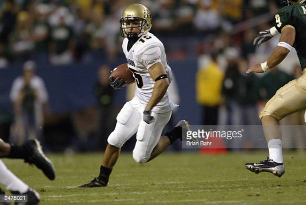 Wide receiver Jeremy Bloom of the University of Colorado Buffaloes carries the ball after making a reception against the Colorado State University...