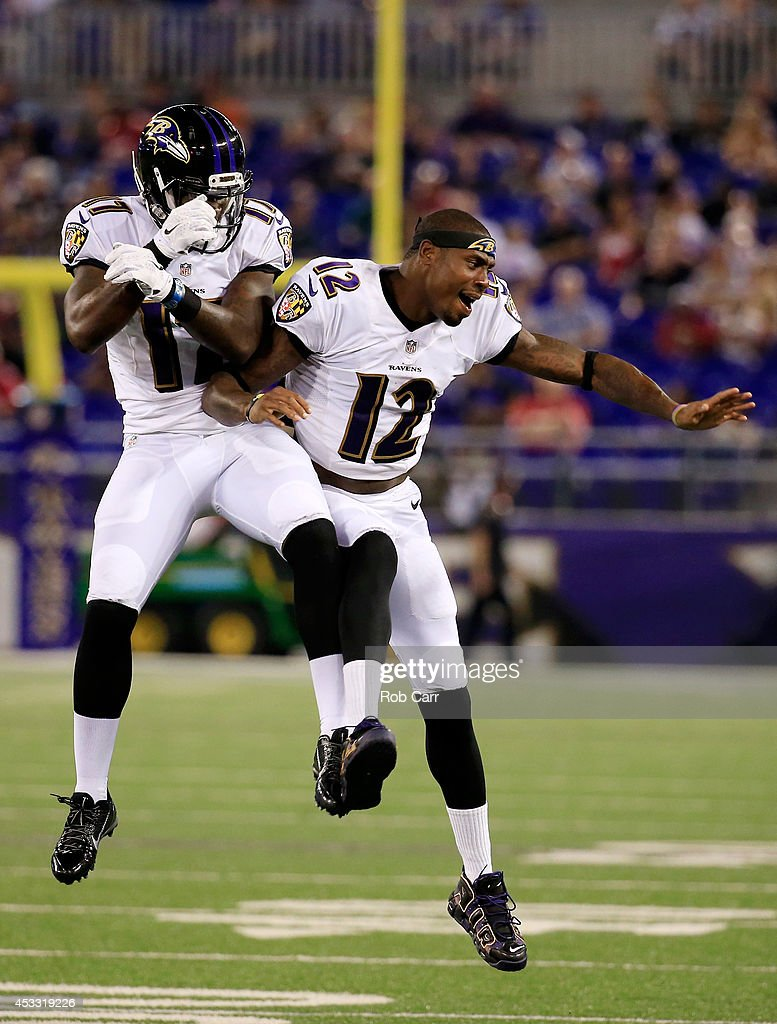 Wide receiver Jeremy Butler #17 of the Baltimore Ravens (L) celebrates with teammate <a gi-track='captionPersonalityLinkClicked' href=/galleries/search?phrase=Jacoby+Jones&family=editorial&specificpeople=4167942 ng-click='$event.stopPropagation()'>Jacoby Jones</a> #12 after scoring a touchdown during the second half of an NFL pre-season game against the San Francisco 49ers at M&T Bank Stadium on August 7, 2014 in Baltimore, Maryland.