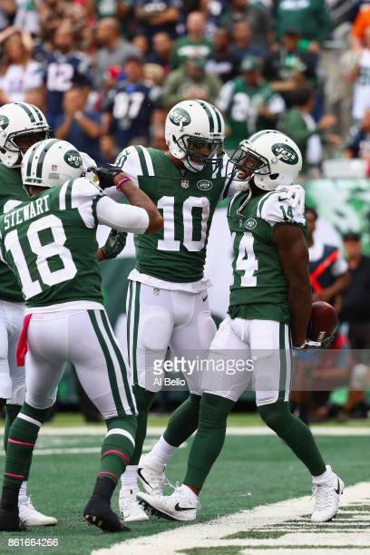 Wide receiver Jeremy Kerley of the New York Jets celebrates his 31yard touchdown with teammate Jermaine Kearse against the New England Patriots...