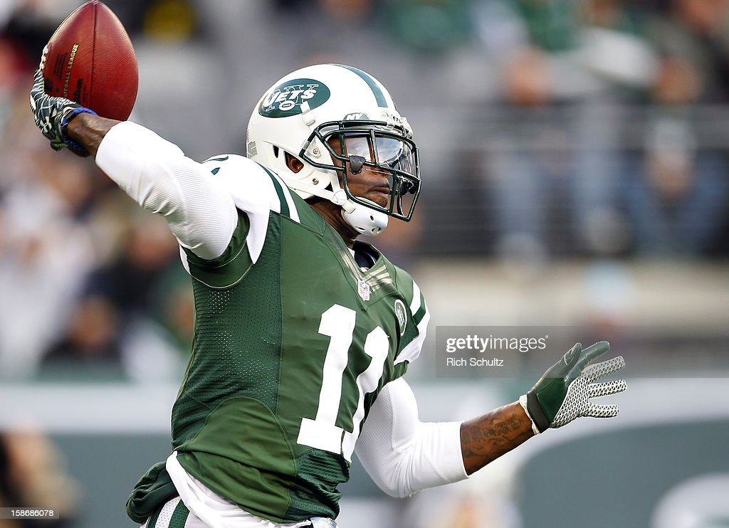 Wide receiver <a gi-track='captionPersonalityLinkClicked' href=/galleries/search?phrase=Jeremy+Kerley&family=editorial&specificpeople=4779050 ng-click='$event.stopPropagation()'>Jeremy Kerley</a> #11 of the New York Jets looks to pass against the San Diego Chargers during the second half at MetLife Stadium on December 23, 2012 in East Rutherford, New Jersey. The Chargers defeated the Jets 27-17.