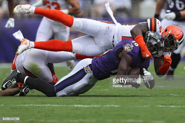Wide receiver Jeremy Maclin of the Baltimore Ravens is tackled by free safety Jabrill Peppers of the Cleveland Browns during the first quarter at MT...