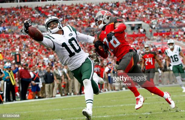 Wide receiver Jermaine Kearse of the New York Jets fails to haul in a pass in the end zone by quarterback Josh McCown while getting pressure from...