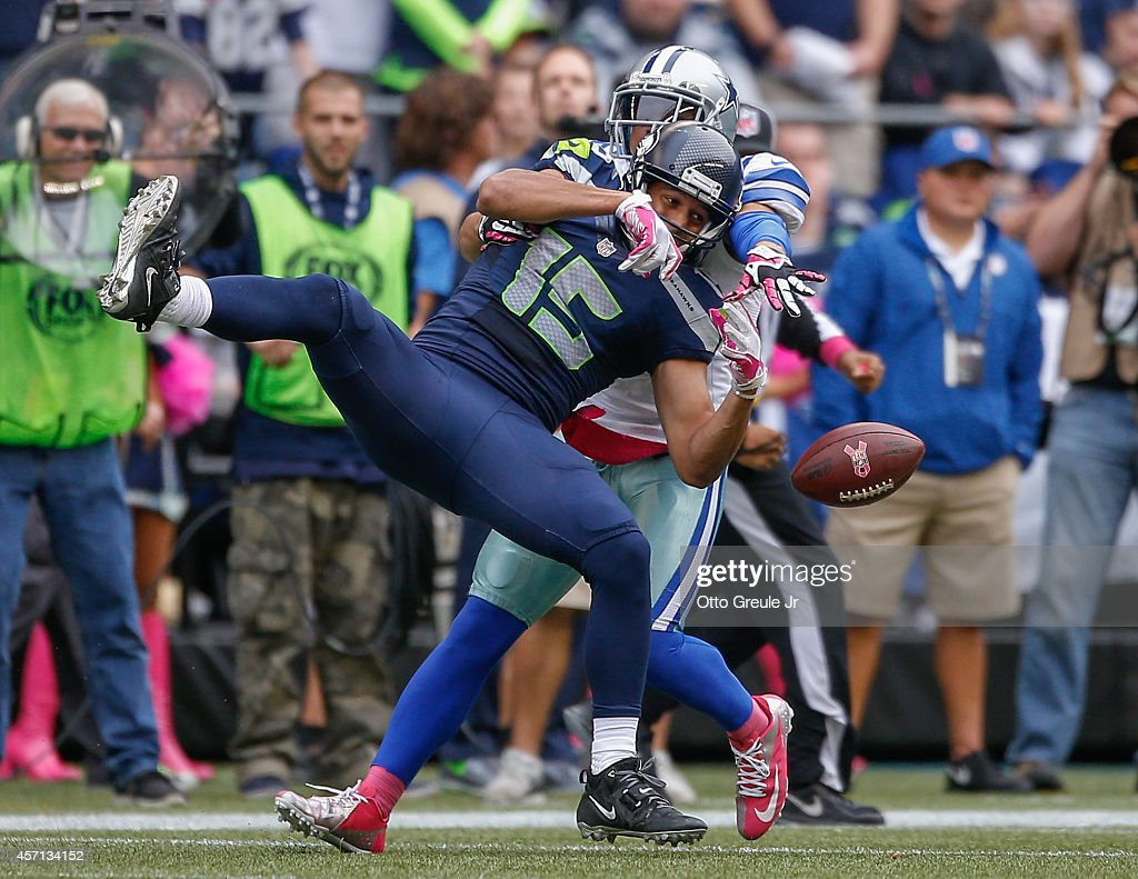 Wide receiver <a gi-track='captionPersonalityLinkClicked' href=/galleries/search?phrase=Jermaine+Kearse&family=editorial&specificpeople=5516767 ng-click='$event.stopPropagation()'>Jermaine Kearse</a> #15 of the Seattle Seahawks can't make the catch against defensive back <a gi-track='captionPersonalityLinkClicked' href=/galleries/search?phrase=Sterling+Moore&family=editorial&specificpeople=7372917 ng-click='$event.stopPropagation()'>Sterling Moore</a> #26 of the Dallas Cowboys at CenturyLink Field on October 12, 2014 in Seattle, Washington. The Cowboys defeated the Seahawks 30-23.