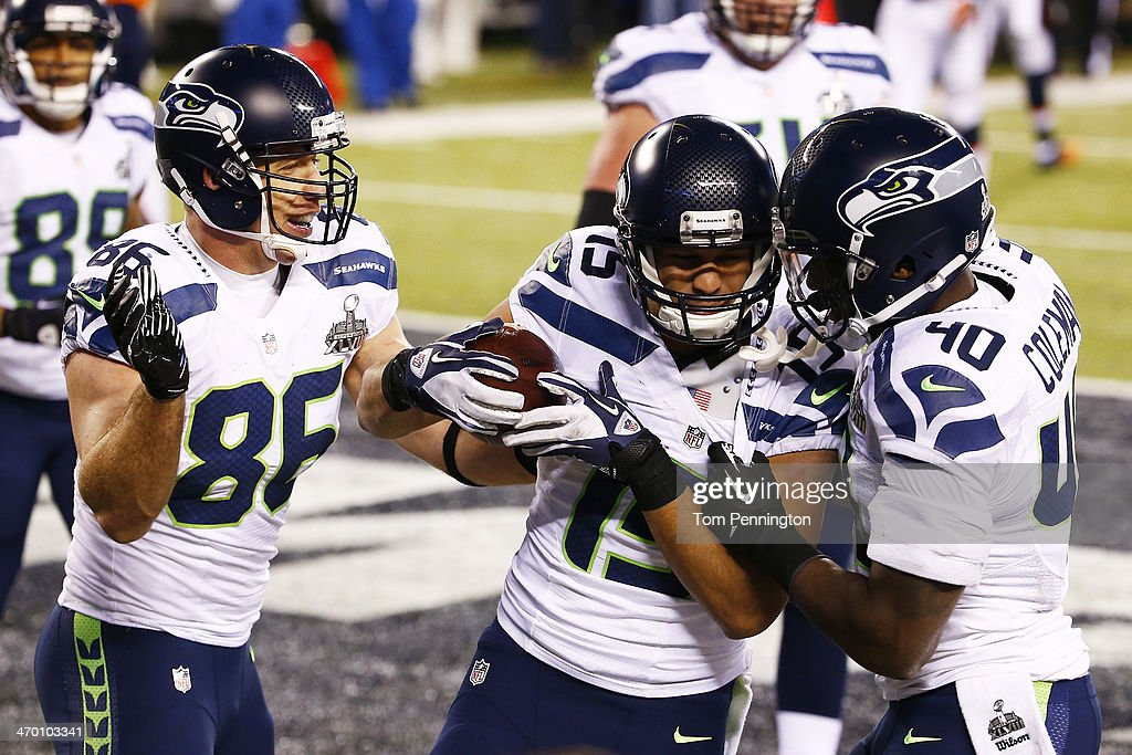 Wide receiver <a gi-track='captionPersonalityLinkClicked' href=/galleries/search?phrase=Jermaine+Kearse&family=editorial&specificpeople=5516767 ng-click='$event.stopPropagation()'>Jermaine Kearse</a> #15 of the Seattle Seahawks celebrates after scoring a 23 yard touchdown during Super Bowl XLVIII against the Denver Broncos at MetLife Stadium on February 2, 2014 in East Rutherford, New Jersey.