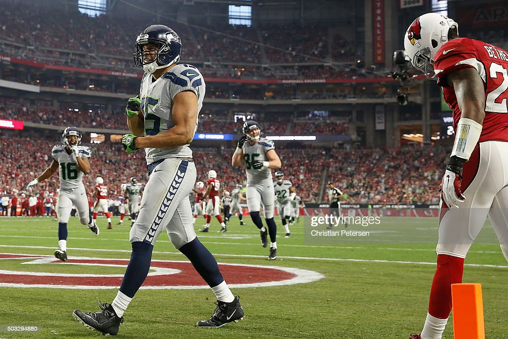 Wide receiver Jermaine Kearse #15 of the Seattle Seahawks celebrats after catching the football to score a 24 yard touchdown during the second quarter of the NFL game against the Arizona Cardinals at the University of Phoenix Stadium on January 3, 2016 in Glendale, Arizona.