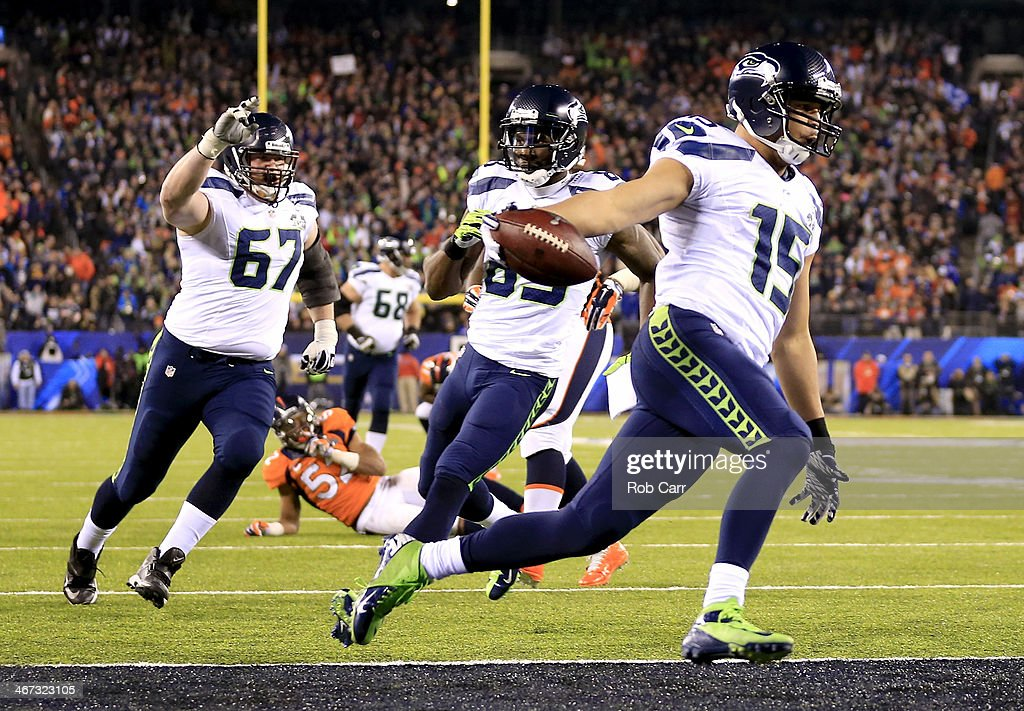 Wide receiver <a gi-track='captionPersonalityLinkClicked' href=/galleries/search?phrase=Jermaine+Kearse&family=editorial&specificpeople=5516767 ng-click='$event.stopPropagation()'>Jermaine Kearse</a> #15 of the Seattle Seahawks runs 23 yards to score a third quarter touchdown against the Denver Broncos during Super Bowl XLVIII at MetLife Stadium on February 2, 2014 in East Rutherford, New Jersey.