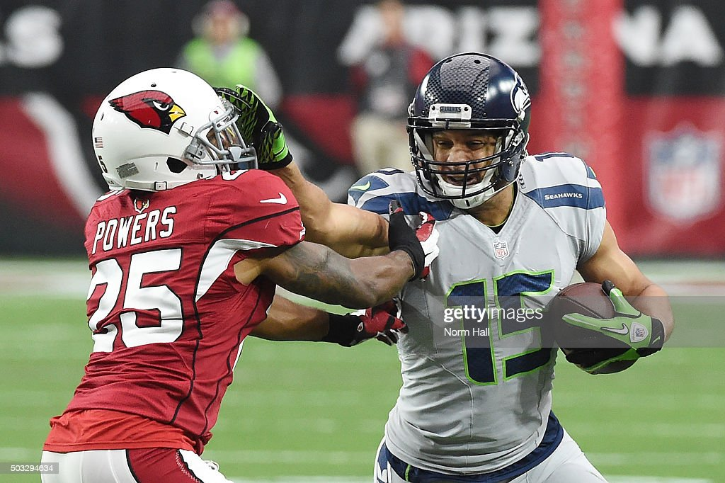Wide receiver Jermaine Kearse #15 of the Seattle Seahawks straight-arms cornerback Jerraud Powers #25 of the Arizona Cardinals in the NFL game at University of Phoenix Stadium on January 3, 2016 in Glendale, Arizona. The Seahawks defeated the Cardinals 36-6.