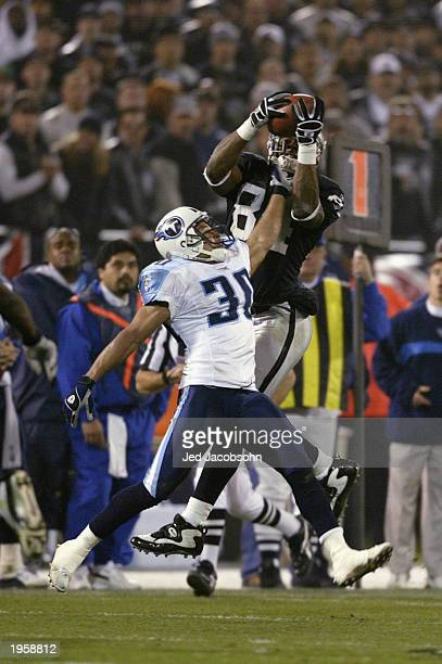 Wide receiver Jerry Porter of the Oakland Raiders makes a flying 14yard catch over cornerback Donald Mitchell of the Tennesse Titans during the AFC...