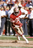 Wide Receiver Jerry Rice of the San Francisco 49ers carries the ball during an NFL football game circa 1991 at Candlestick Park in San Francisco...