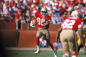 Wide receiver Jerry Rice of the San Francisco 49ers carries the ball in an undated photo during a game against the Los Angeles Rams at Candlestick...