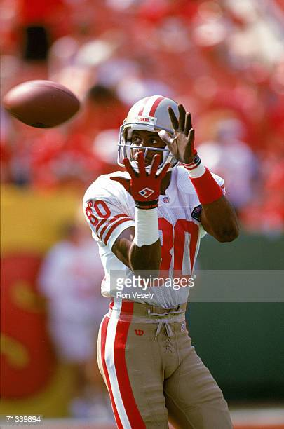 Wide receiver Jerry Rice of the San Francisco 49ers catches a pass during warmups before the game against the Kansas City Chiefs at Arrowhead Stadium...