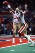 Wide receiver Jerry Rice of the San Francisco 49ers celebrates on his way to the end zone for a touchdown in Super Bowl XXIV against the Denver...