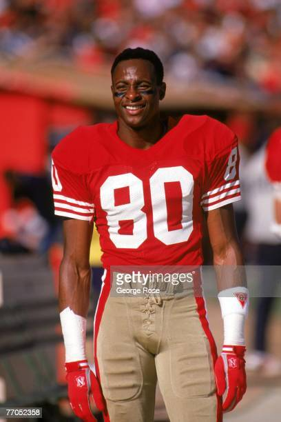 Wide receiver Jerry Rice of the San Francisco 49ers looks on from the sidelines during a game against the Green Bay Packers at Candlestick Park on...