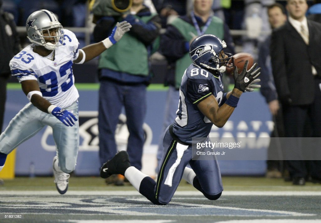 ... Wide receiver Jerry Rice 80 of the Seattle Seahawks makes a 27 yard  touchdown catch ... 98f5adff3