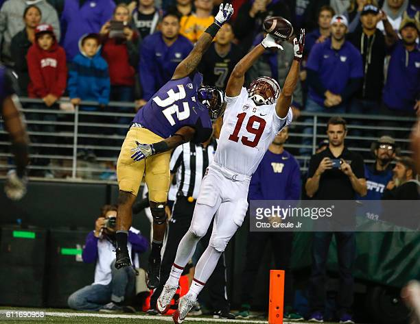 Wide receiver JJ ArcegaWhiteside of the Stanford Cardinal catches a touchdown pass against defensive back Budda Baker of the Washington Huskies in...