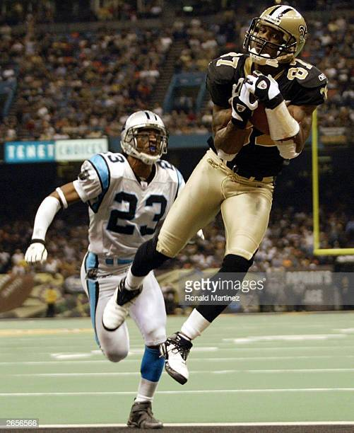 Wide receiver Joe Horn of the New Orleans Saints catches a pass for a touchdown past the defense of Reggie Howard of the Carolina Panthers October 26...