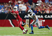 Wide receiver John Brown of the Arizona Cardinals catches the football against strong safety James Ihedigbo of the Detroit Lions in the third quarter...