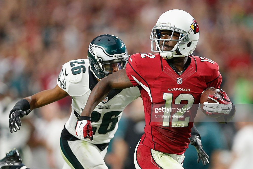 Wide receiver <a gi-track='captionPersonalityLinkClicked' href=/galleries/search?phrase=John+Brown+-+American+Football+Wide+Receiver&family=editorial&specificpeople=224611 ng-click='$event.stopPropagation()'>John Brown</a> #12 of the Arizona Cardinals runs with the football en route to scoring on a 75-yard touchdown reception against cornerback <a gi-track='captionPersonalityLinkClicked' href=/galleries/search?phrase=Cary+Williams+-+American+Football+Player&family=editorial&specificpeople=10178470 ng-click='$event.stopPropagation()'>Cary Williams</a> #26 of the Philadelphia Eagles in the fourth quarter during NFL game at the University of Phoenix Stadium on October 26, 2014 in Glendale, Arizona.