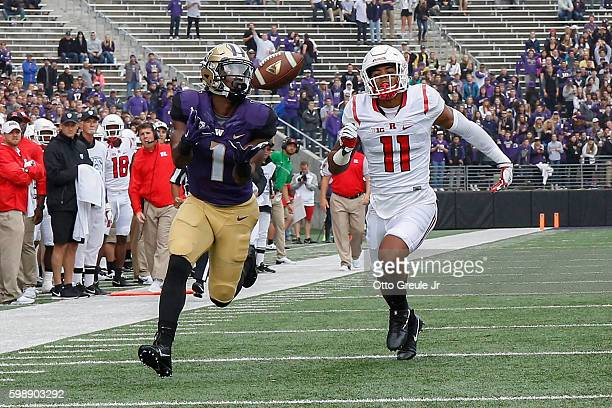 Wide receiver John Ross of the Washington Huskies catches a touchdown pass against Isaiah Wharton of the Rutgers Scarlet Knights on September 3 2016...