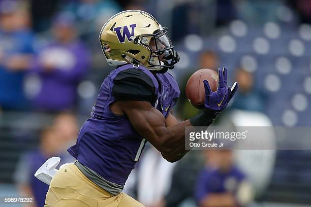 Wide receiver John Ross of the Washington Huskies catches a touchdown pass against the Rutgers Scarlet Knights on September 3 2016 at Husky Stadium...