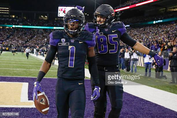 Wide receiver John Ross of the Washington Huskies is congratulated by tight end David Ajamu after scoring a touchdown against the USC Trojans on...
